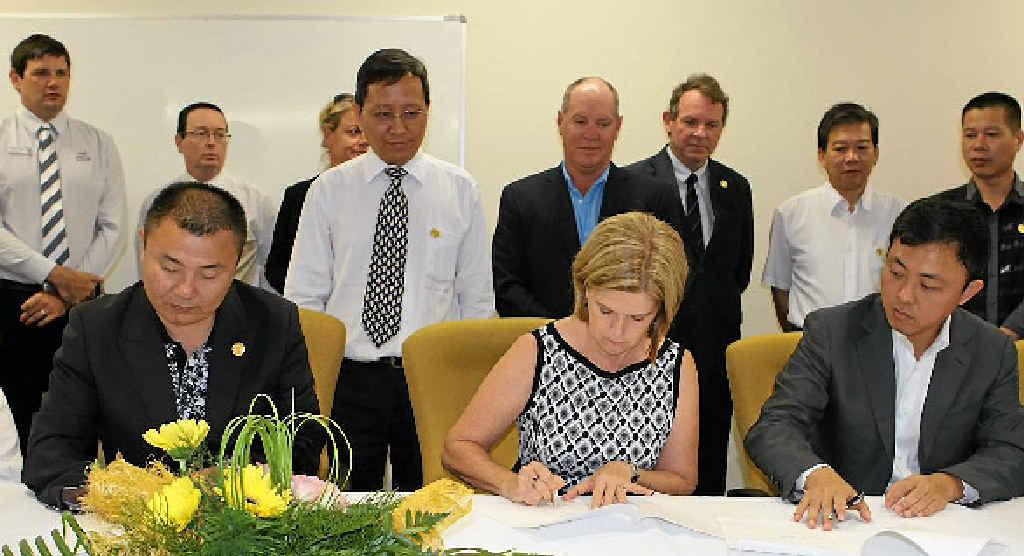 CAEAI president Raymond Wang, Whitsunday Mayor Jennifer Whitney and Esteem Capital director Jason Ji at the signing ceremony.