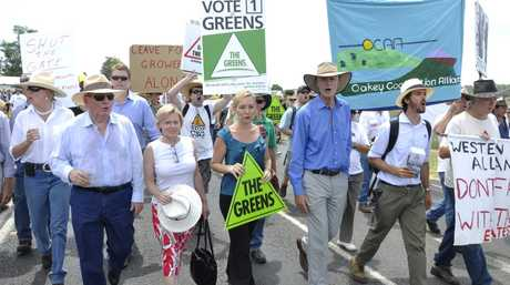 (Front from left) Alan Jones, Libby Connors of The Greens, Greens senator Larissa Waters, Lock the Gate president Drew Hutton walk with fellow protestors at the Lock the Gate Alliance and the Oakey Coal Action Alliance protest march on New Hope Acland coal dump near Jondaryan, Monday, February 20, 2012. Photo Tim Braban / The Chronicle