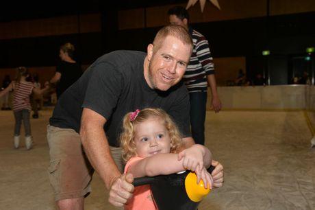Keith Devenish with daughter Miranda on the last day of Ice Skating in Mackay Photo Tony Martin / Daily Mercury
