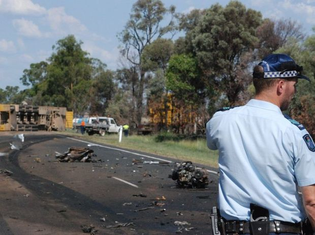 The wreckage of a fatal crash near Chinchilla. The cattle truck can be seen overturned in the distance.