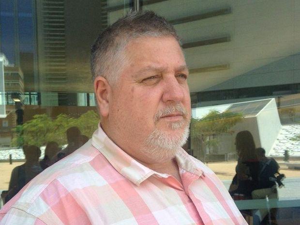 Gladstone fisherman Trevor Falzon talks outside Brisbane Planning and Environment Court.