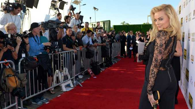 Margot Robbie arrives at the 19th annual Critics' Choice Movie Awards at the Barker Hangar on Thursday, Jan. 16, 2014, in Santa Monica, Calif.