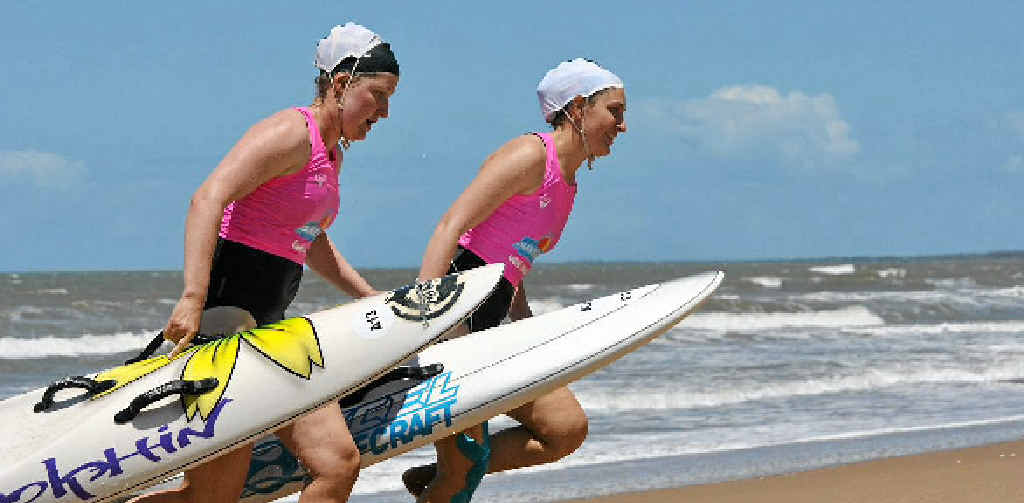 SURF'S UP: Hayley Bowman and Erin Gibson star at the 2014 Wide Bay Capricorn Surf Rescue Championships held at Moore Park Beach.