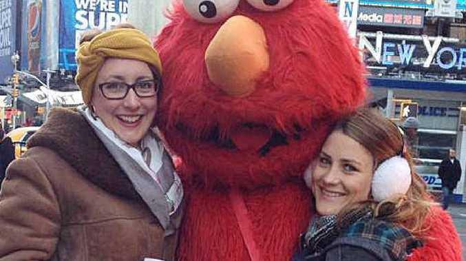 LIFE SAVER: Rebecca Tallis and Amy Newberry with Elmo in New York City.