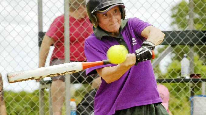 HIT PARADE: Blues Sistas batter Cam Hogan prepares to wallop another drive during the FNC Softball match at Lismore's Albert Park on Saturday.