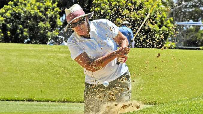 SAND FLIES: Lynne Hay chips out of trouble on the 18th hole during the latest competition at Ballina Golf Club.