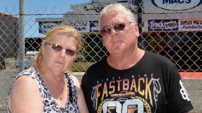 Judi and Chris Fredrickson outside MACS Engineering. Mr Fredrickson has been re-employed by the company but is still fighting for his lost entitlements.