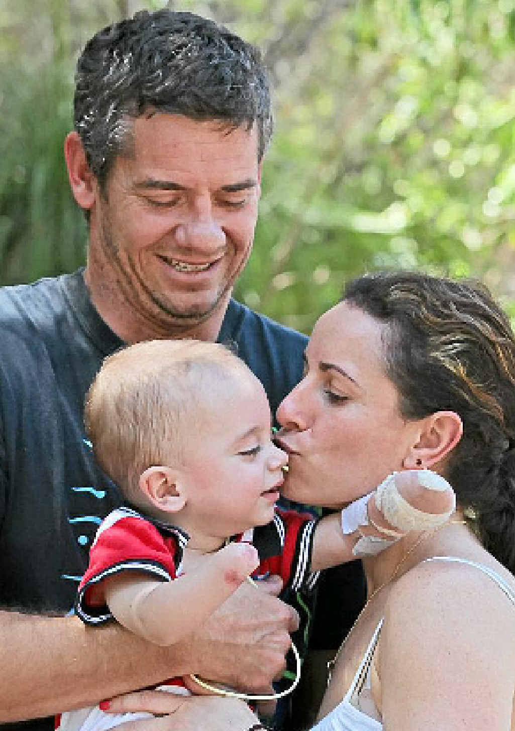 Finn Smith with parents Jason and Sarah.