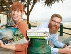 "BOOK REVIEW: Sunshine Coast Council library staff Maddison Wilkins and Jake Hudson promote a ""pop-up"" library that will be at Kings Beach today to explain services and gain feedback about the Libraries Plan 2014-2024."