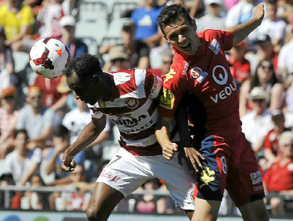 HEADS UP: Western Sydney's Youssouf Hersi (left) and Adelaide's Isaias clash during yesterday's A-League match at Coopers Stadium in Adelaide.