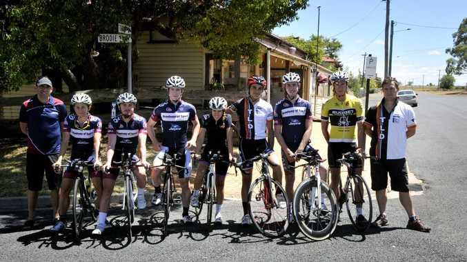 Senior QAS cycling coach Nick Formosa (left) at Nobby on Saturday with riders Katrin Garfoot, James Thompson, Daniel Fitter, Jess Pratt, Sam Allen, Ryan Cavanough, Alex Waller and Dave Silk.