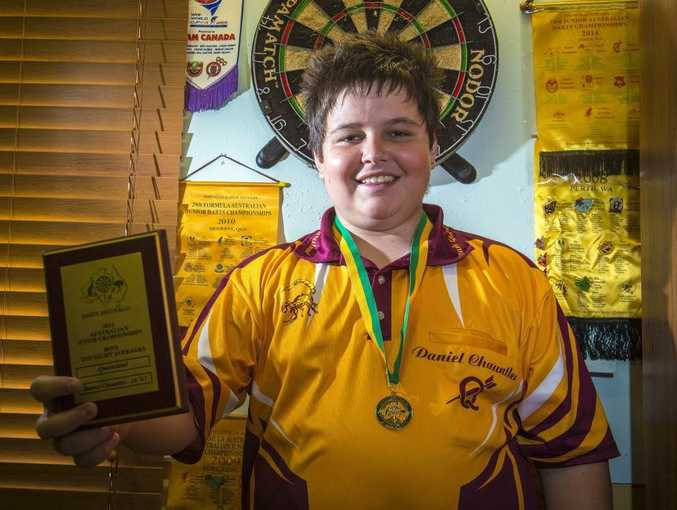 Daniel Chauntler, 15, led his Queensland team to victory at the Australian Darts Junior Championships.
