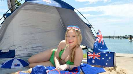 Karlee Cooper gets into the spirit of Australia Day as Sails Sports Bar gets ready for its Australia Day beach party.
