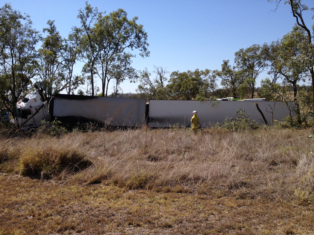 A crane has been called in to right the overturned trailer of a B-double that rolled on the Gore Highway south of Toowoomba.