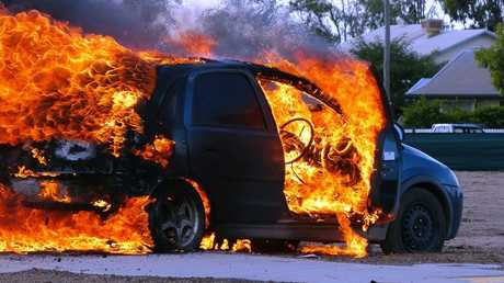 A Holden Barina goes up in flames in Currey St at Roma.