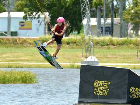 AIR TIME: Danielle Gutschlag, 11, who took up wakeboarding in December, perfects her technique at Gowake Mackay.