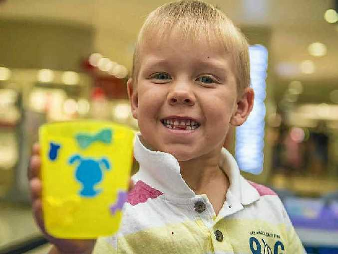 GREEN THUMB: Jack Roberts, 5, learnt gardening skills at the grassy heads workshop at Stockland.