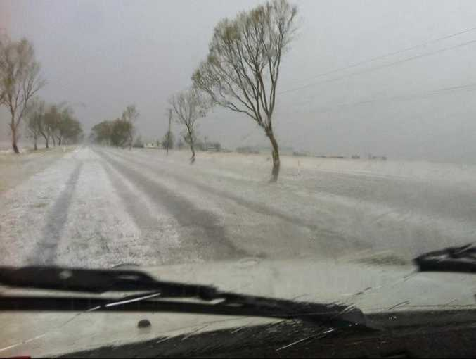 Hail covers a road near King's Creek Bridge at Clifton after a severe thunderstorm hit the area about 5.45pm.