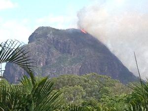 Fire burns close to top of Mt Tibrogargan