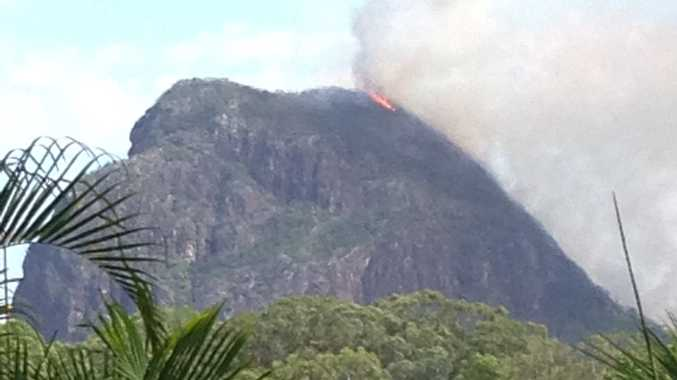 A fire is burning on Mt Tibrogargan.