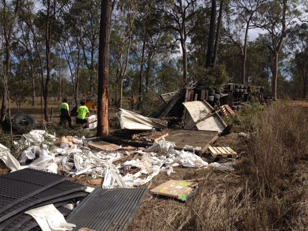 Wreckage from the crash of a prime mover and two trailers is strewn through the bush.