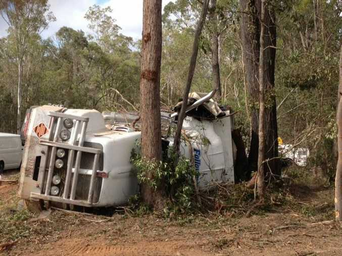 The semitrailer came to rest on its side in bushland beside the Bruce Hwy about 13km south of Maryborough.