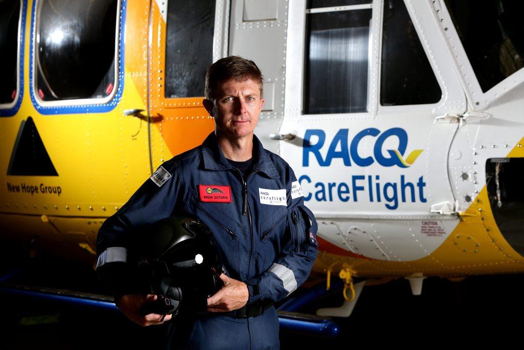RACQ rescue chopper crewman Brian Guthrie was in Bundaberg doing rooftop retrievals.