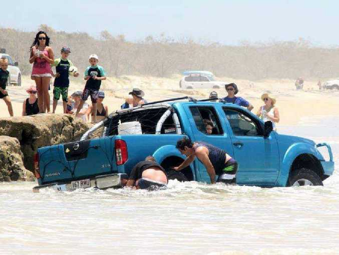 GONE: The water starts to rise, but luckily help was at hand and the vehicle was pulled free soon after.