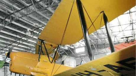 TIGER MOTH: Housed in the Evans Head Memorial Aerodrome Museum with a smaller replica alongside.