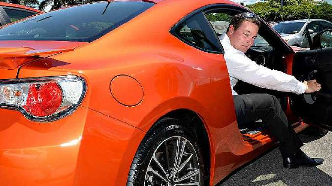 SMOKIN': Mackay's Autcorner Toyota sales manager Ricky Bird shows off a Toyota 86 in a new bright colour called Inferno. Mr Bird said Mackay purchases reflected the results of a national colour survey.