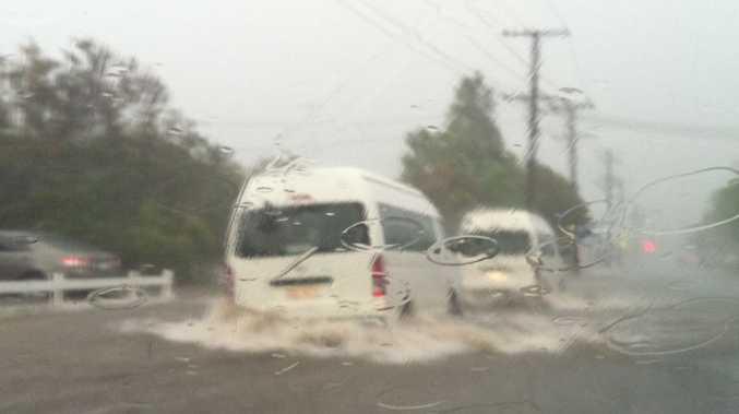 Gatton Star journalist Tom Threadingham was driving home yesterday when he witnessed this flash flooding at William St, Gatton around 6.30pm.