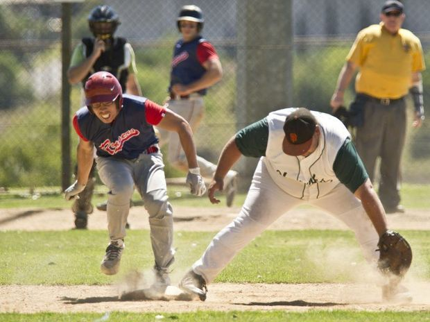 Toowoomba Rangers player Scott Ho is out at first base last Sunday against Beenleigh at Commonwealth Oval.