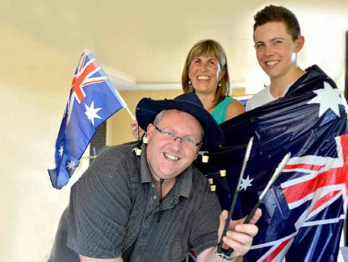 AUSSIES, EH: Kiwis Dean, Tania and Sam Comerford will become Australian citizens tomorrow and are prepared to have Australia Day all wrapped up.
