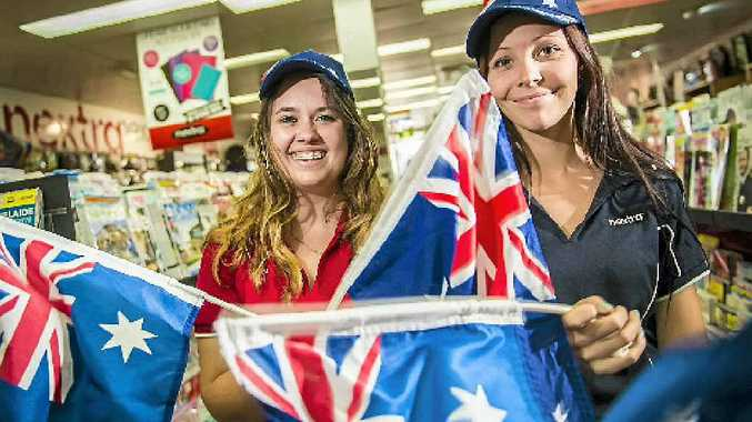 WEEKEND EXTRA: Kate Harbourne and Dimity Rauter of Nextra Valley News with the Australia Day car flags available free with this weekend's Observer.