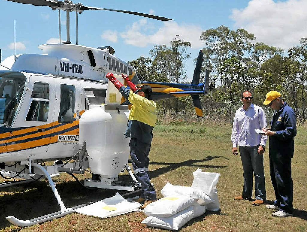 STERILISED ANTS: Clint Mason loads the chopper with fire ant bait to spread throughout the Yarwun area.