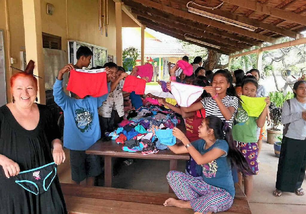 FANCY PANTS: Orphanage children receive their underwear.