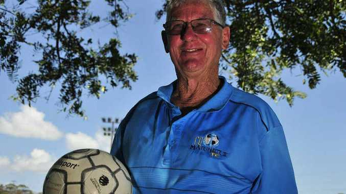 FOOTBALL MAD: Brian Niven, President of CQ Mariners FC, is on the ball for Gladstone.