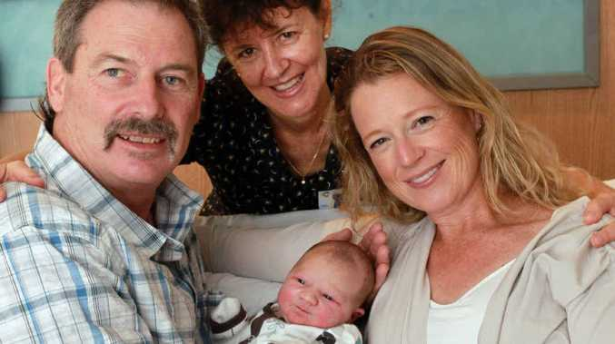 NEW ADDITION: Cienna Canavan-Hanisch with her proud parents Carly Canavan-Hanisch and Greg Hanisch and their midwife, Robyn Menzel (centre).