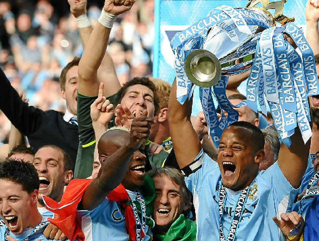 BIG TIME: Manchester City captain Vincent Kompany celebrates his team's EPL premiership win. The owners of the EPL giants recently acquired an 80% stake of A-League club Melbourne Heart (players pictured inset).