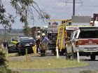 Emergency services at the scene of a fatal crash involving a truck and car on the Gore Hwy near Westbrook.