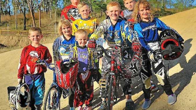 Ben Dunphy, Darcy Ryan, Charlie Ryan, Toby Dunphy, Mackenzie Ryan (front), and Mitchell and Fraser Hannan (back) are ready to race, with club president Chris Dunphy (behind). The Harbour City BMX club is having a much brighter year without its track damaged by floods.