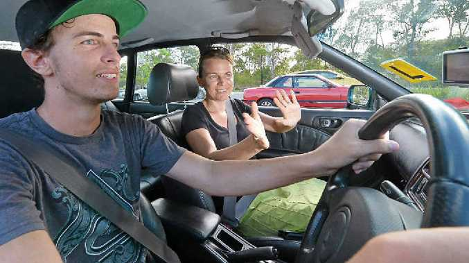 NO MUM: Jesse Gibson gets some driving tips from his mother Danielle Gibson. The RACQ argues that some parents are passing on their bad habits to their children.