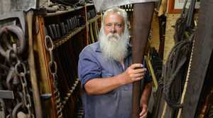 Axe and egg beater collectors Steve and Maree Lehmann with some of their collection. Maree has 400 egg beaters and Steve has 1700 axes. Photo: Sarah Harvey / The Queensland Times