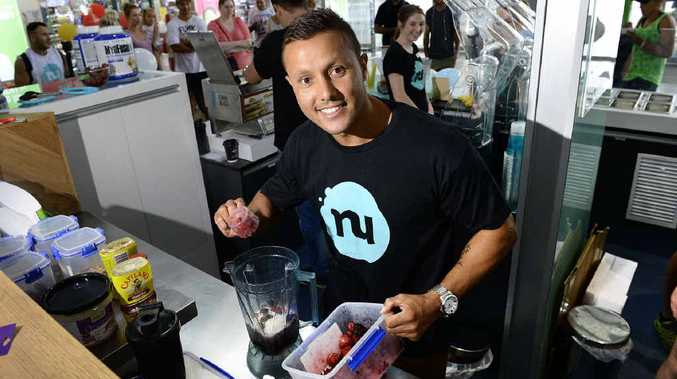HEALTHY MIX: Former Queensland origin player Scott Prince prepares a smoothie at Nutrition Station, a new Riverlink store.