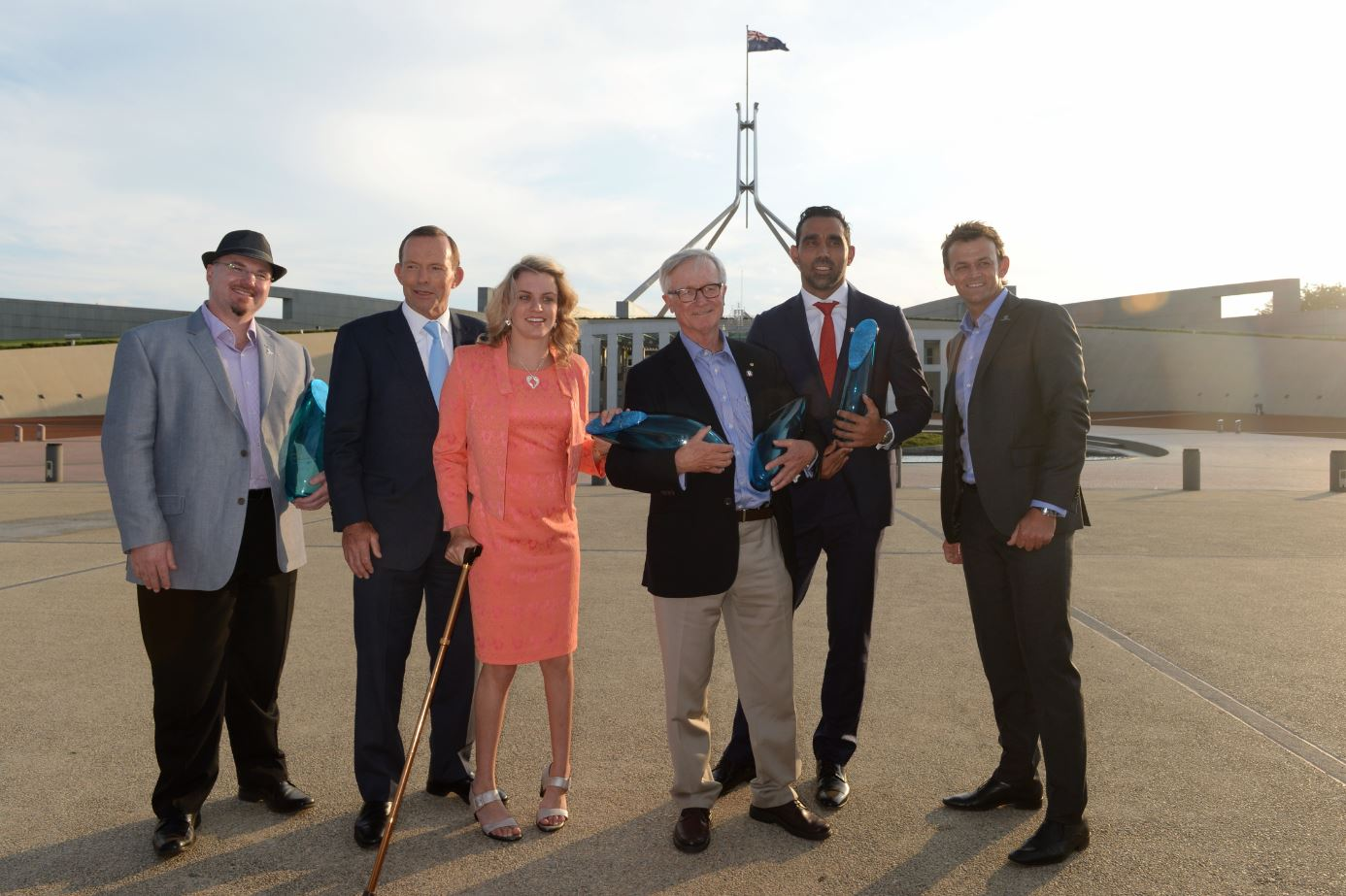 (L-R) Australia's Local Hero 2014 Tim Conolan, Prime Minister Tony Abbott, Young Australian of the Year 2014 Jacqueline Freney, Senior Australian of the Year 2014 Fred Chaney, Australian of the Year 2014 Adam Goodes and chair of National Australia Day Council Adam Gilchrist pose for a photograph after a ceremony at Parliament House in Canberra, Saturday, Jan. 25, 2014.