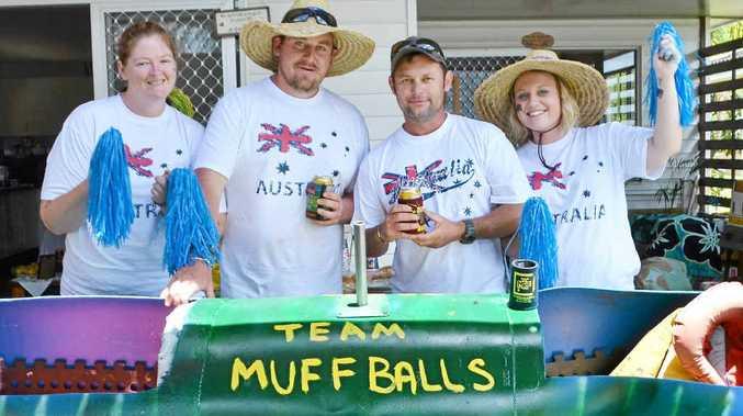 RAFT BUILDERS: Team Muff Balls including Jaimi-Lee Toohey, Kurt 'Muff' Rayner, Bianca Mavir and Billy 'Balls' Eller, of Coraki, preparing for the raft race at the Australia Day celebrations.