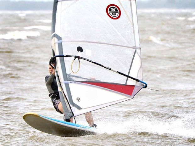 Windsurfer Tom Williams makes the most of the windy weather and the public holiday at Town Beach.