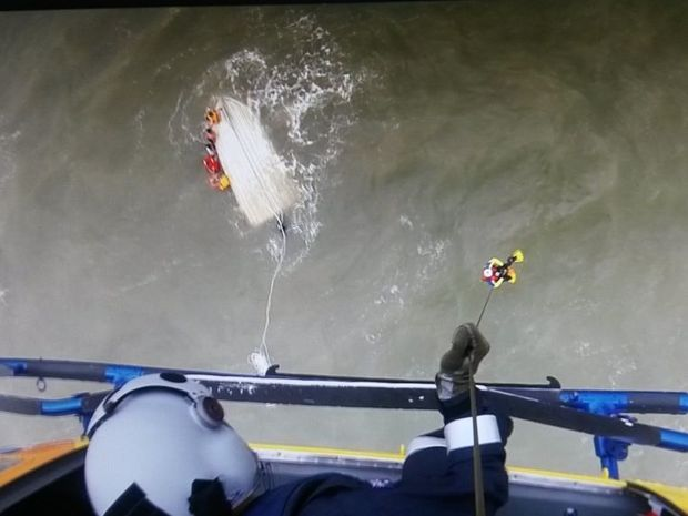 One of the family members being winched by the RACQ Capricorn Rescue Helicopter.