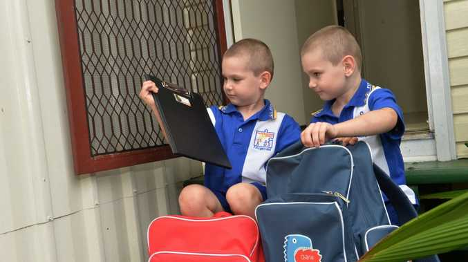 Twin brothers Jackson left, and Charlie Hammond prepare for their first day at school.