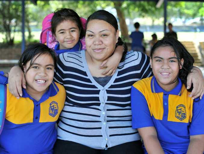 BIG DAY: New to Gladstone South, Mana Malo with children Ayraina, 9 and Tylar, 5.